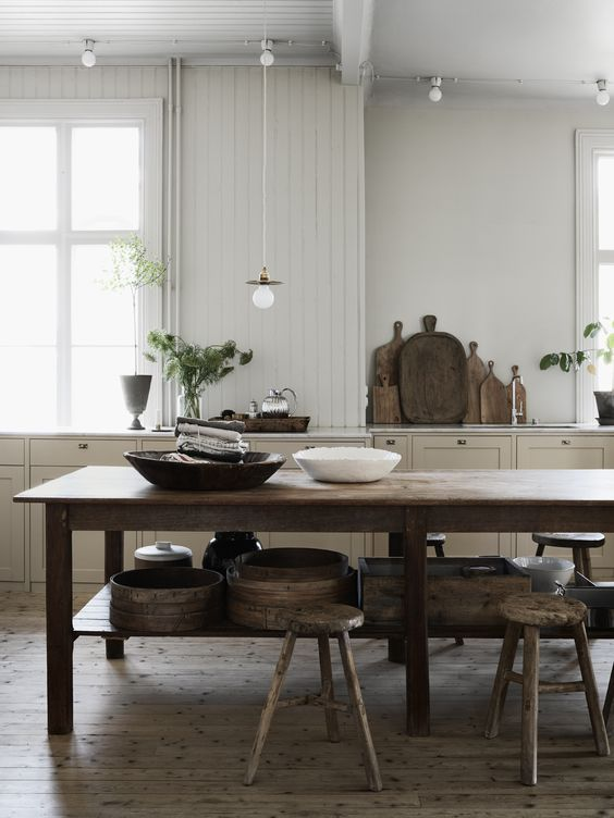 kitchen-with-big-old-wooden-table-and-raw-wooden-stools